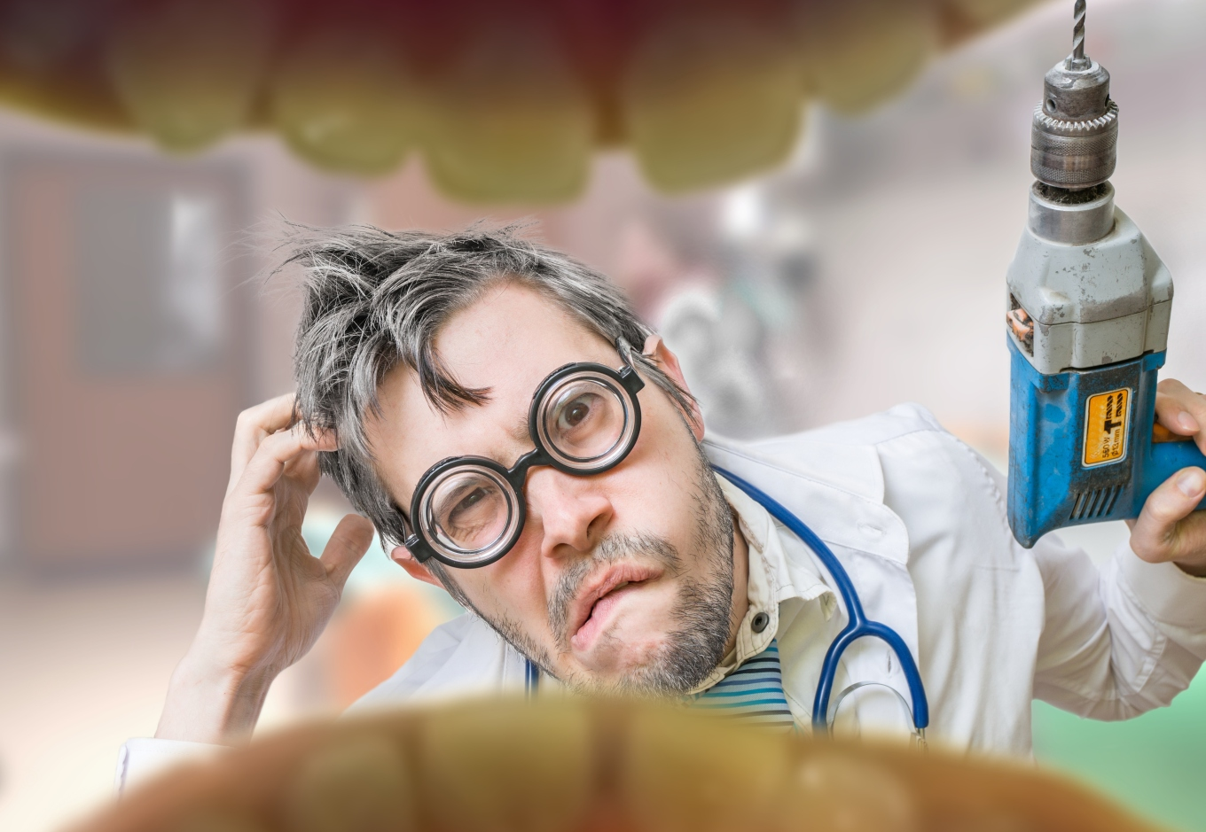 Uncertain crazy dentist doctor looks into mouth to drill tooth
