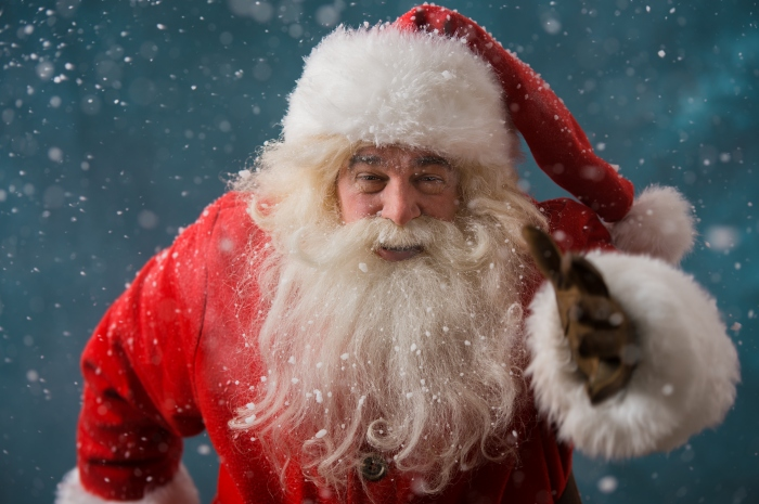 Santa Claus running outdoors at North Pole. Trying to be in time working on delivery gifts to children
